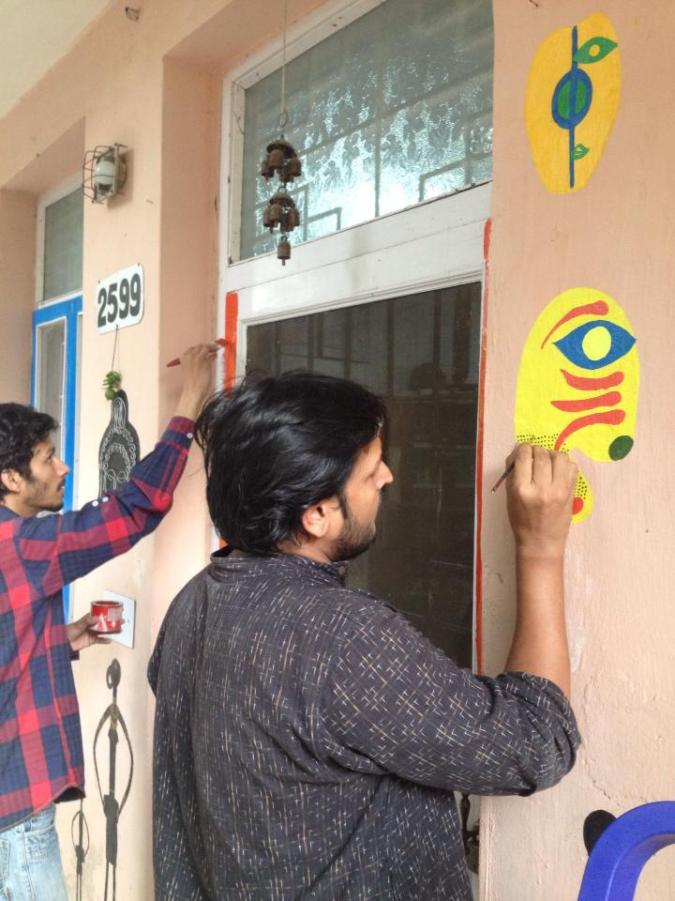 Dhiraj painting one of the masks