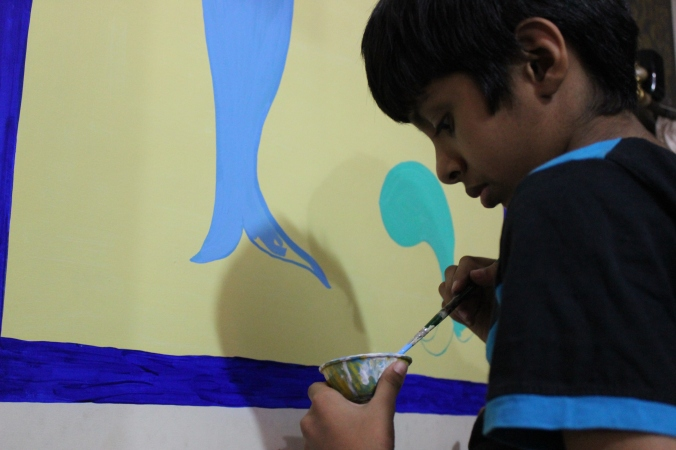 Amrit trying his hands on the painting