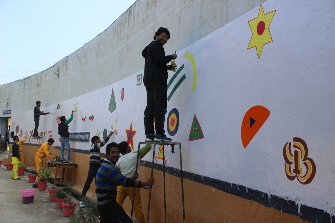 In the male ward we painted a 50 ft wall with the help of prisoners.