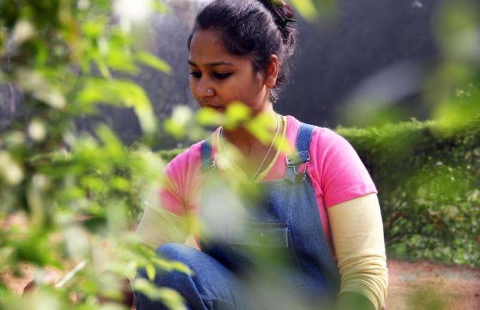 Meenakshi is engrossed in the canvas