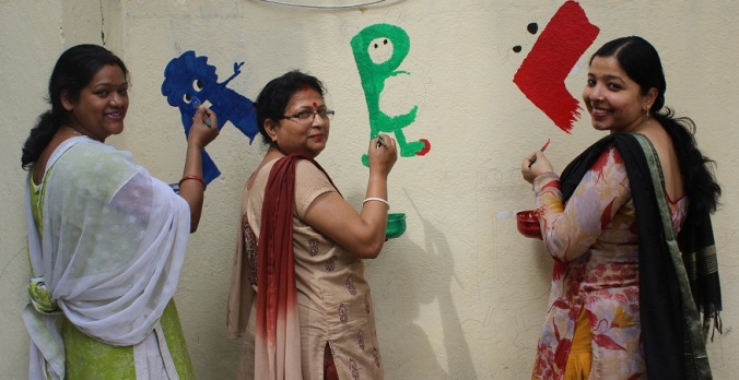Teachers decided to paint Alphabets with a twist
