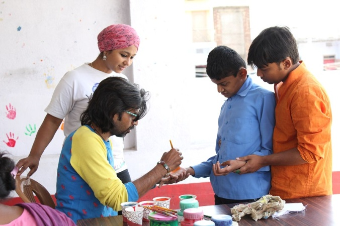 The work started with painting he hands of those kids