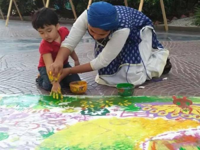 Meenakshi painting with a kid